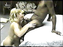 Vintage interracial fucking of this big breasted blonde in a ponytail