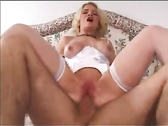 Tight white lingerie and sexy stockings on the ass fucked blonde