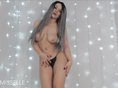 Solo webcam girl with spectacular natural tits does a hot striptease