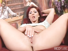 Luscious solo redhead Ana spreads her legs and finger fucks her hot cunt