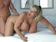 Busty Kimberly Kupps having sex in a bedroom