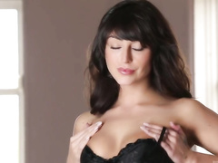 Christina Leia in hot black corset enjoys masturbating herself