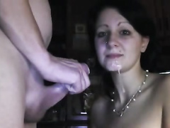 Girlfriend with a good grip gives him a handjob live on webcam