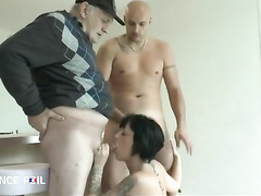 A milf is being drilled with 2 cocks in her room