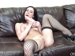 Pornstar loves to fuck herself with a dildo