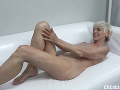 Horny old blonde Evana likes to suck dicks