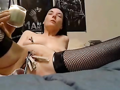 Hot mom putting clothes pegs on her vaginal lips.