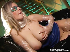 Blonde milf loves to wear her latex clothes and masturbating