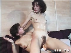 Hairy pussy gets fucked by big strap-on dick